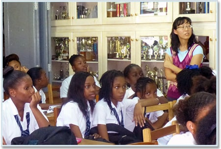 Students of St. Vincent Girls High School listen to Trinity SOM lecturers