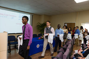 Students step up to be robed in the White Coat Ceremony at Trinity School of Medicine, Caribbean medical school