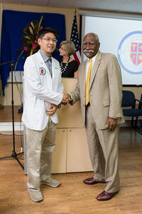 Incoming Students Shake the hand of Sir Frederick Ballantyne, Governor General of St. Vincent and the Grenadines
