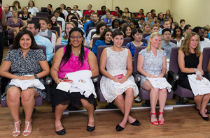 Trinity Students await the moment to wear their White Coat - September 2014 Entry Term Class
