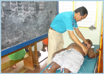 Dr. Ibrahim exams a patient during Village Doctor outreach