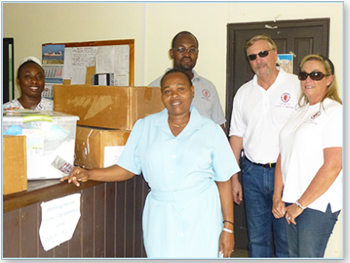 Dr. Nedd, the Wilson and Hospital Staff Receive Donations