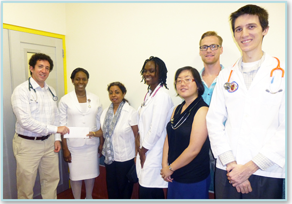 Jonah Hirshberg presents cheque to Dr. Datta
