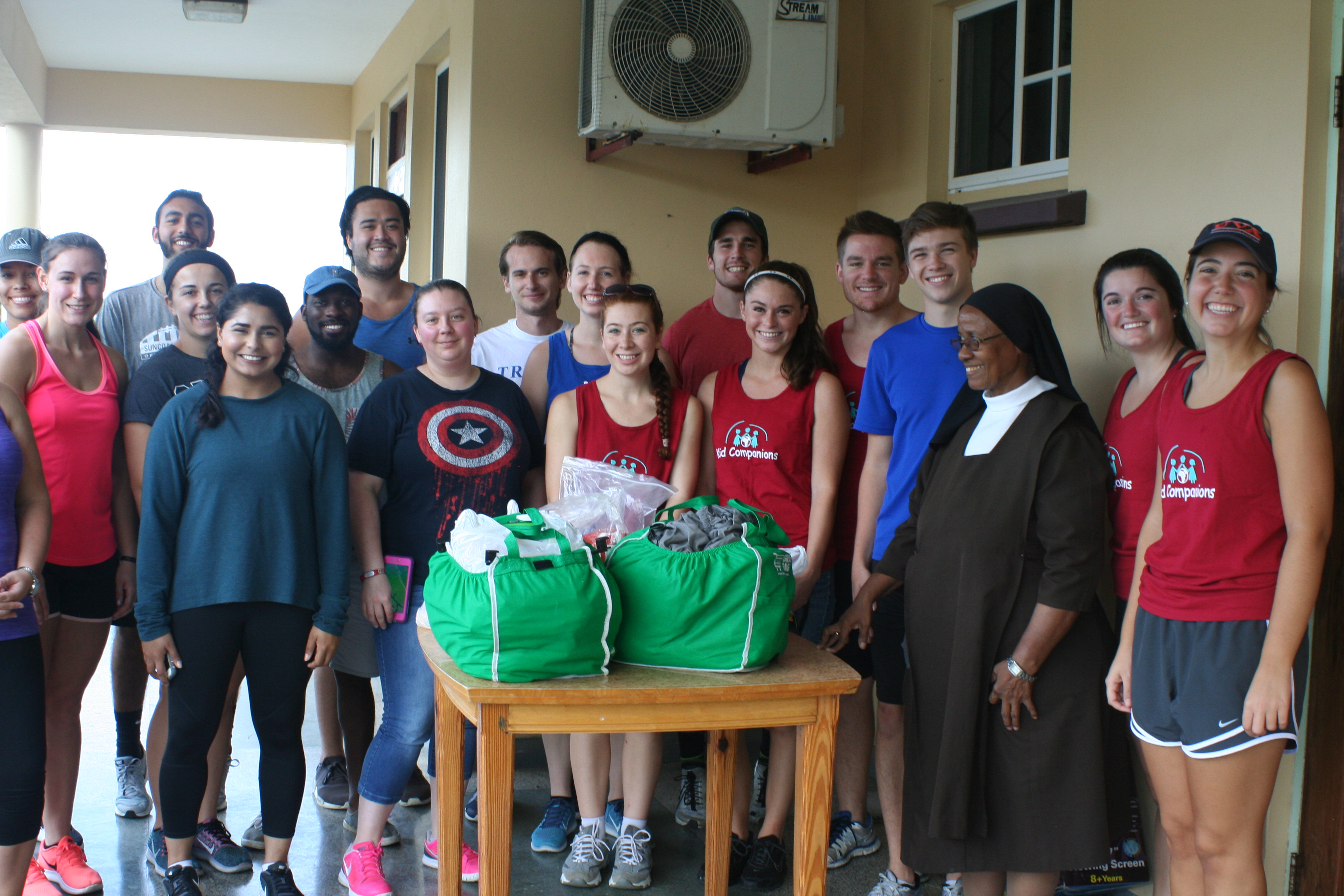 Trinity School of Medicine students donating supplies for the orphanage