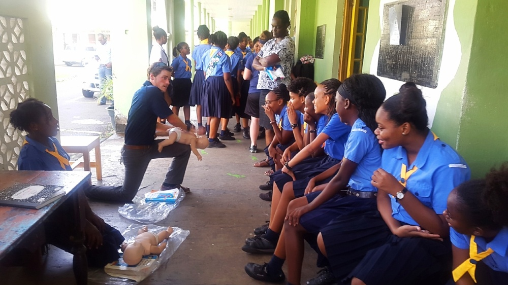 Trinity School of Medicine students teaching Girl Guides First Aid