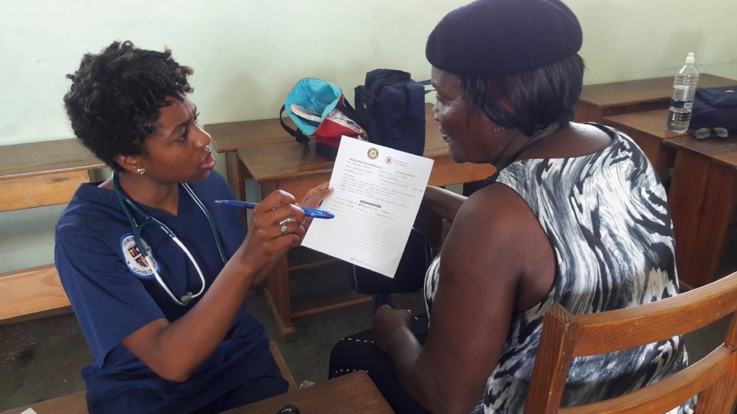Trinity student sharing results with the patient