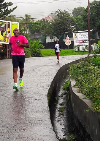 Runners putting out a strong effort amidst the rain