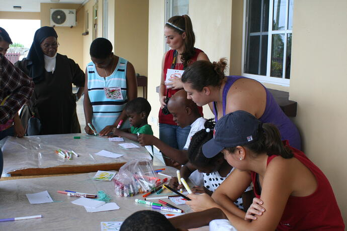 Trinity students working on art projects with their friends at St. Benedict's Children's Home
