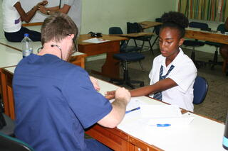 Trinity students taking vitals.