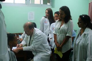 Cheyenne and Emily pay attention as Dr. Coplen works-597248-edited.jpg