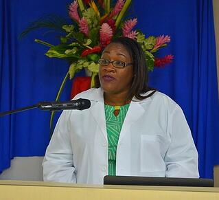 Dr. Jack-Edwards, Trinity's associate dean of admission and student affairs, reads the students' names out receive their white coat.