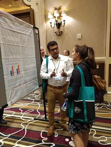 Dr. Solanki discusses his poster with an interested participant