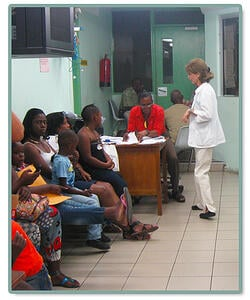 Doctors engage with the many parents and patients awaiting their consultations in St. Vincent and the Grenadines