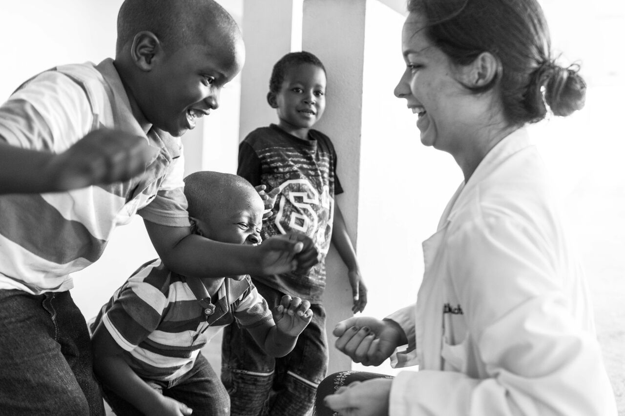 Trinity School of Medicine student Emily interacting with the patients