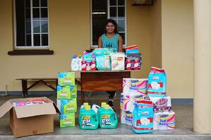 Farah stands with items to be donated