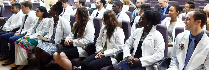 New Trinity School of Medicine students at January white coat ceremony