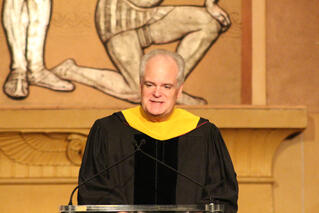 HCA's Dr. Bruce Deighton welcomes Trinity graduates to the profession of medicine