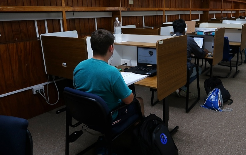 Trinity students in the library
