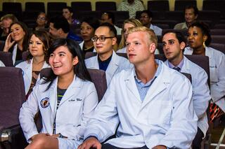 Trinity 5th term students look on during awards