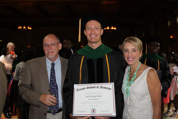 Dr. Boland graduating from Trinity School of Medicine