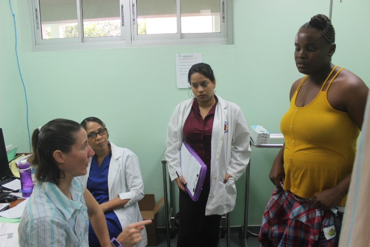 Surgeons talk to the parents of a patient on consultation day
