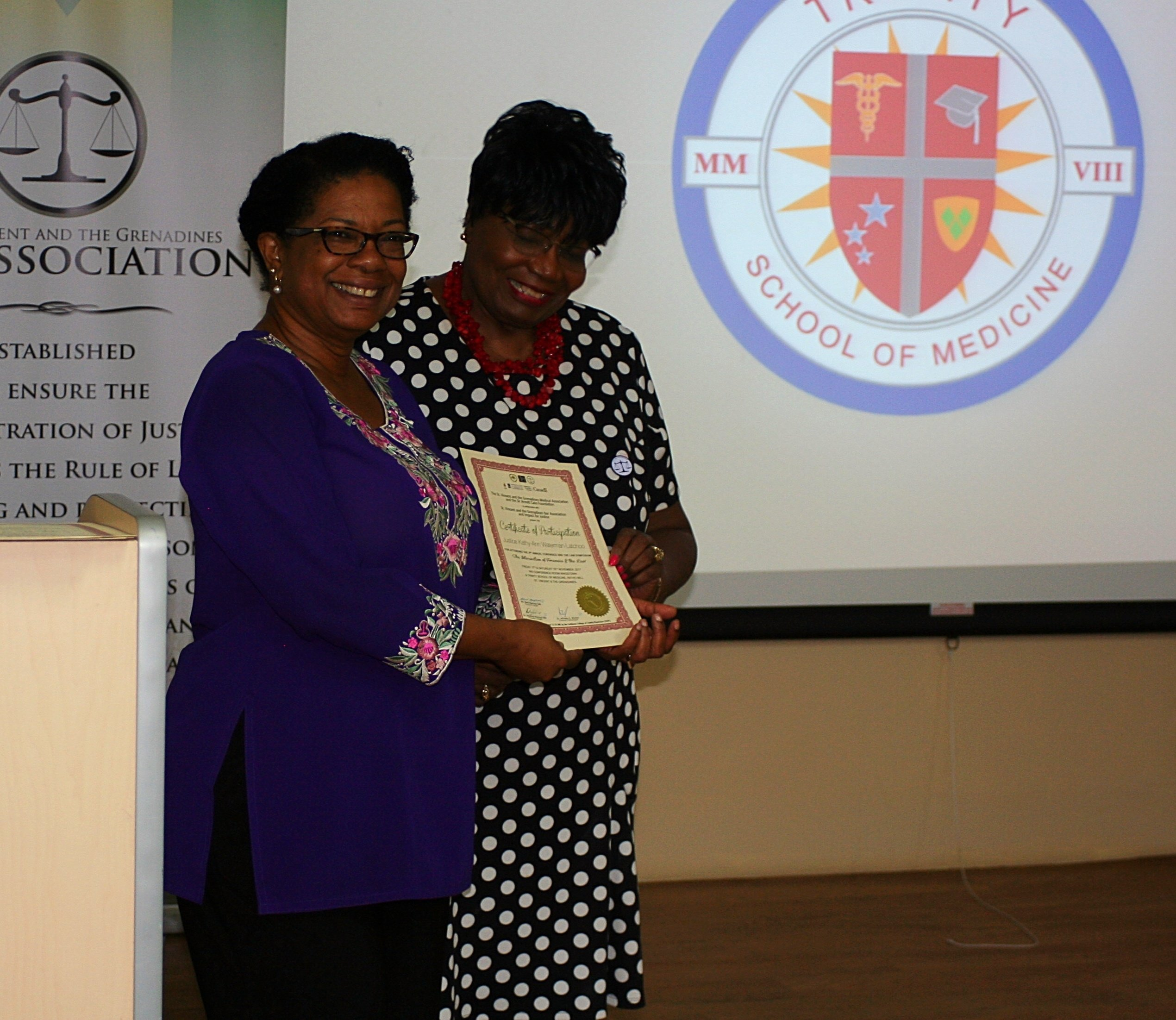 Justice Latchoo receives her certificate of participation-310853-edited.jpg