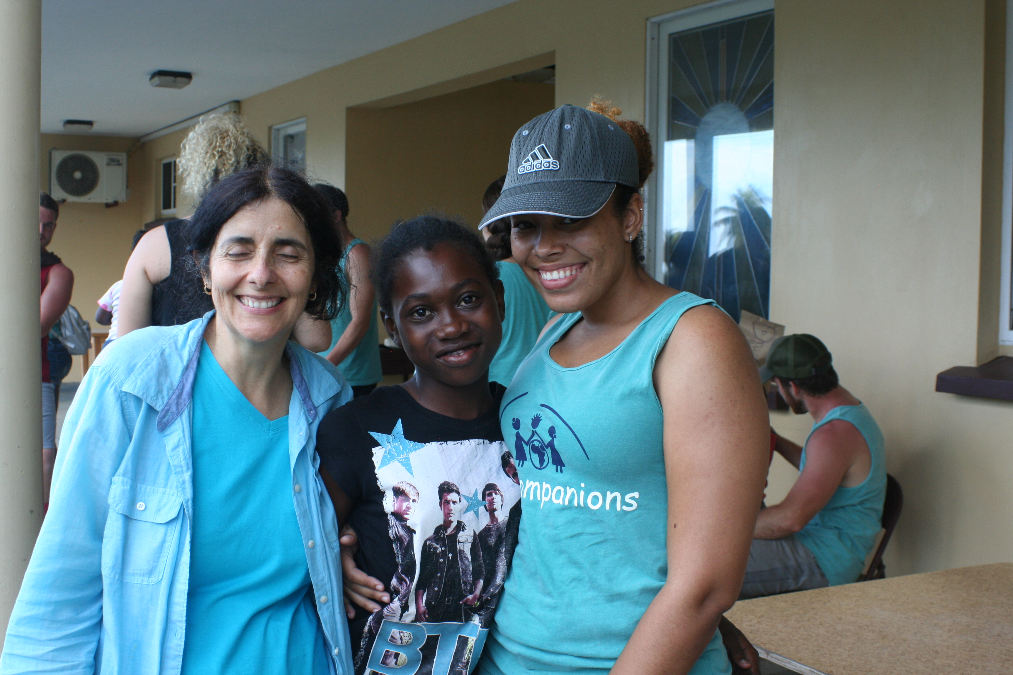 New member Maria Guardia with orphan and other club member