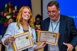 Dr. Andreas Reymann and Sarah Seyffert with her two awards