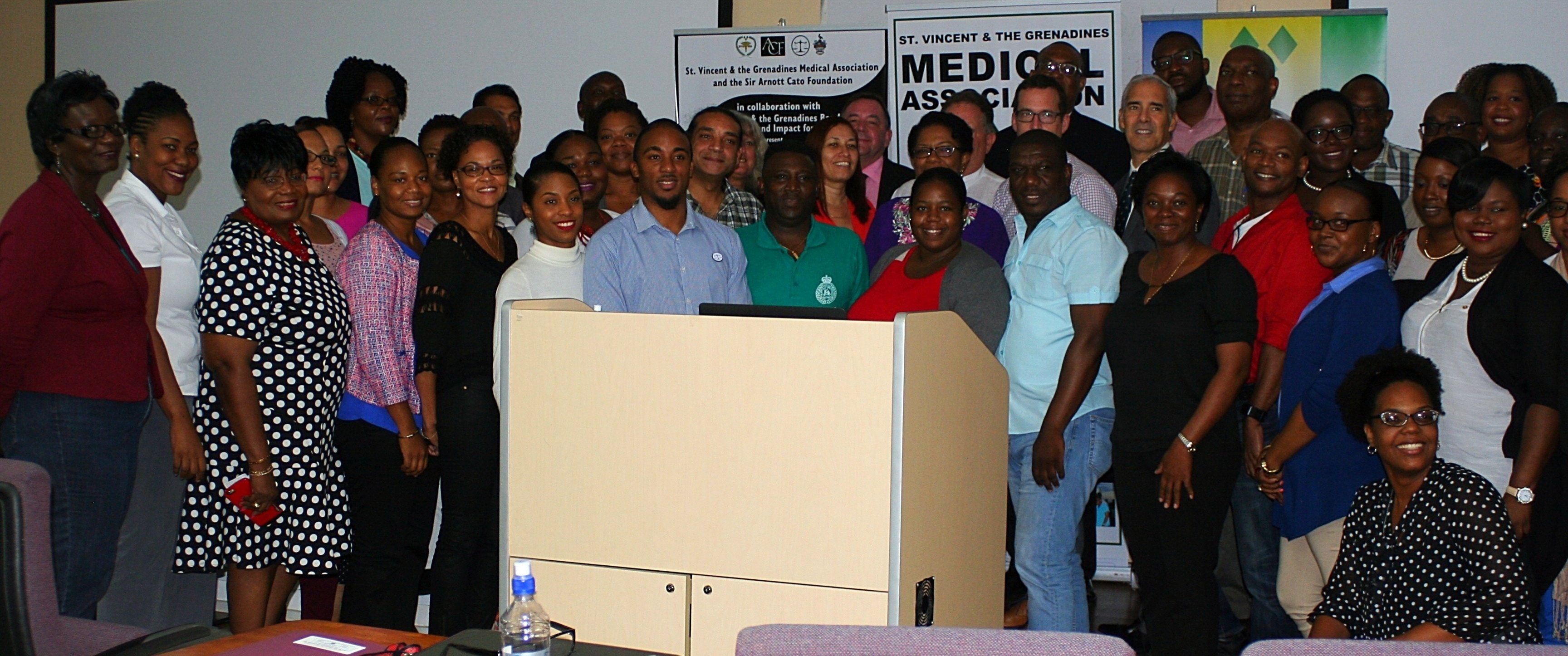 Some of the gathered attendees and presenters at Trinity School of Medicine