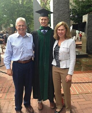 Tyler with his parents at his graduation from UVA