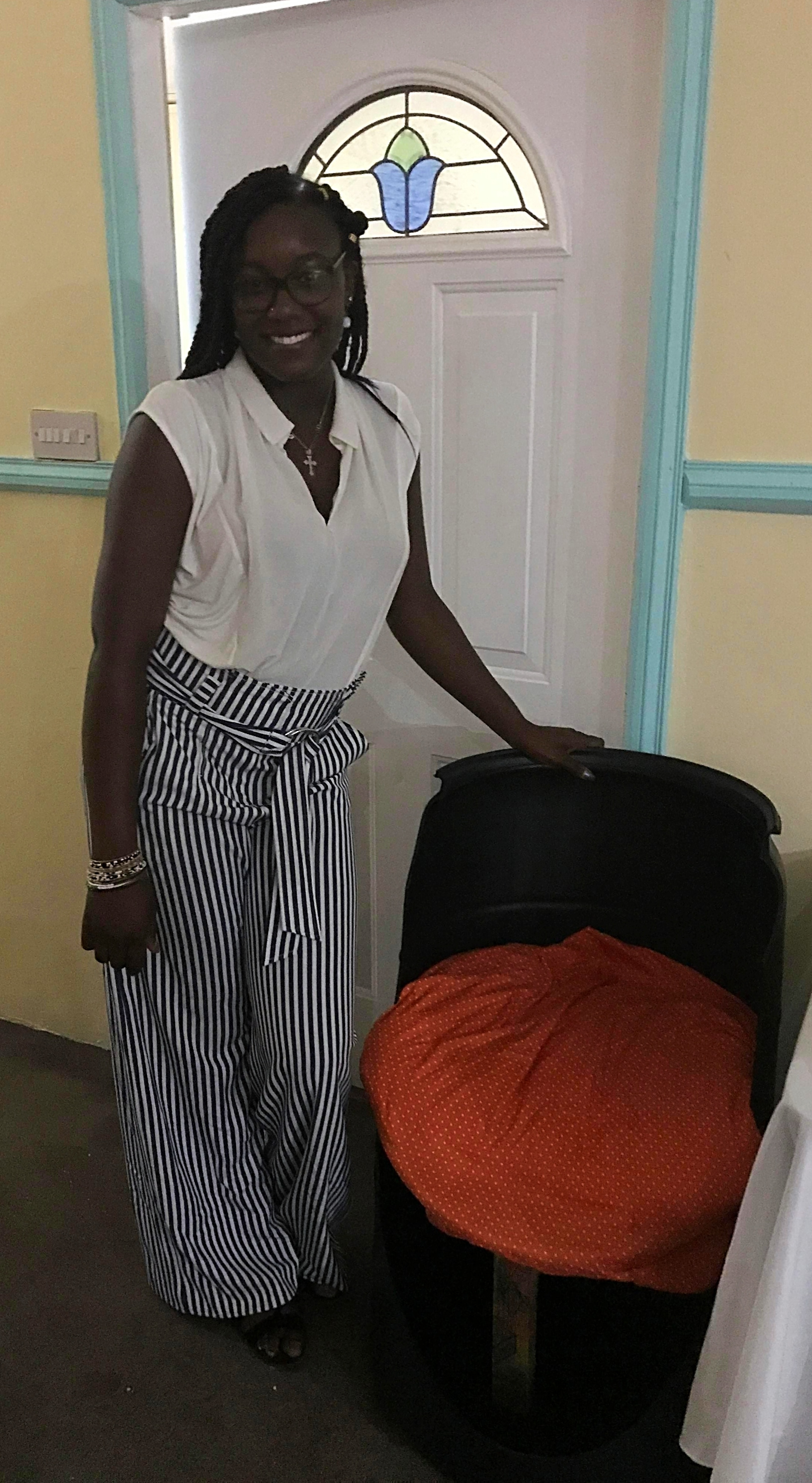 Trinity student Gbemisola Johnson with her upcycled chair