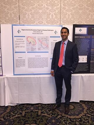 Dr. Ezekiel Presenting Medical Research
