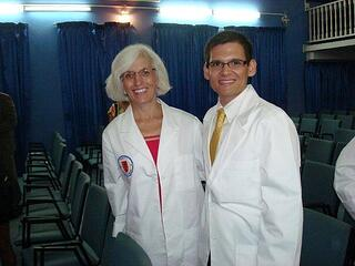A fresh faced Dr. Hindman at her Trinity white coat ceremony