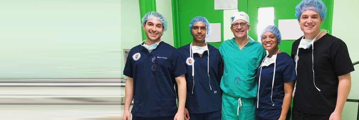 Trinity School of Medicine Students outside Operating Theater with World Pediatric Project surgeon