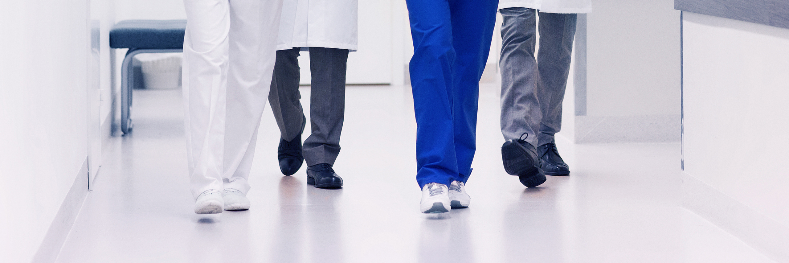 doctors walking down hospital hall